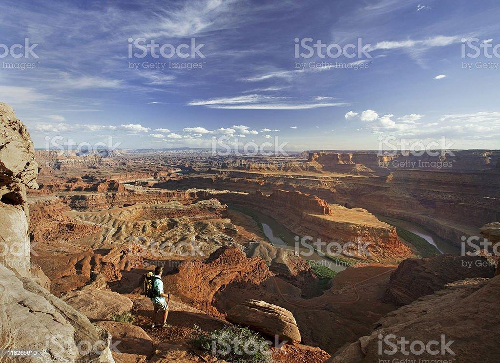 Hiker Standing On Rocks Looking At View In Moab, Utah stock photo