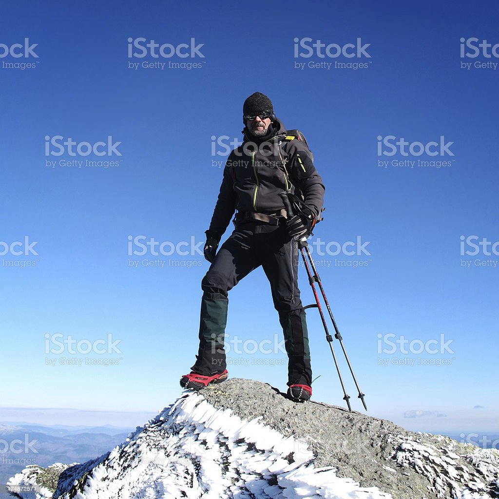 Hiker stands triumphantly on Mt Madison, USA stock photo