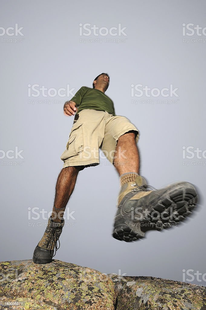 Hiker Stepping Over Rocky Terrain royalty-free stock photo