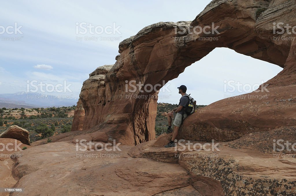 Hiker Taking a Break at Broken Arch royalty-free stock photo