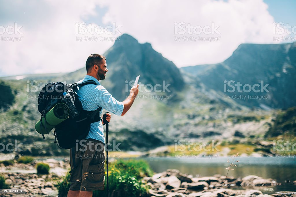 Hiker taking a picture stock photo