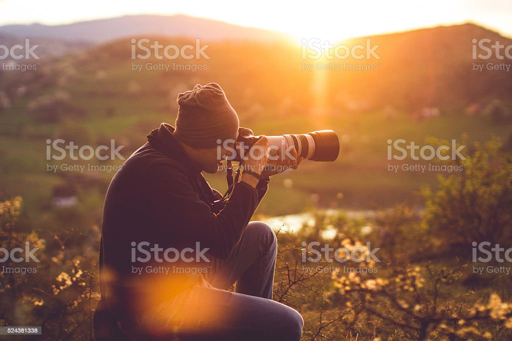 Hiker taking photos stock photo