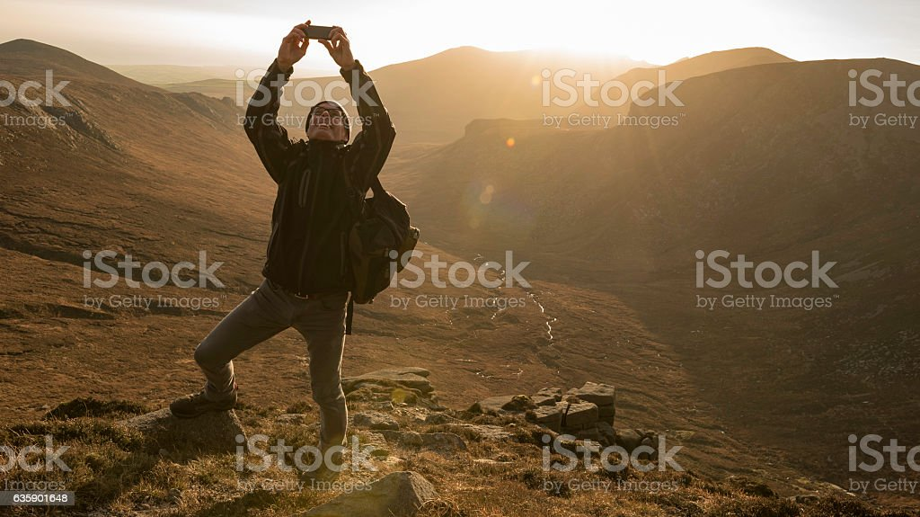 Hiker taking selfie, Mourne Mountains, Northern Ireland stock photo