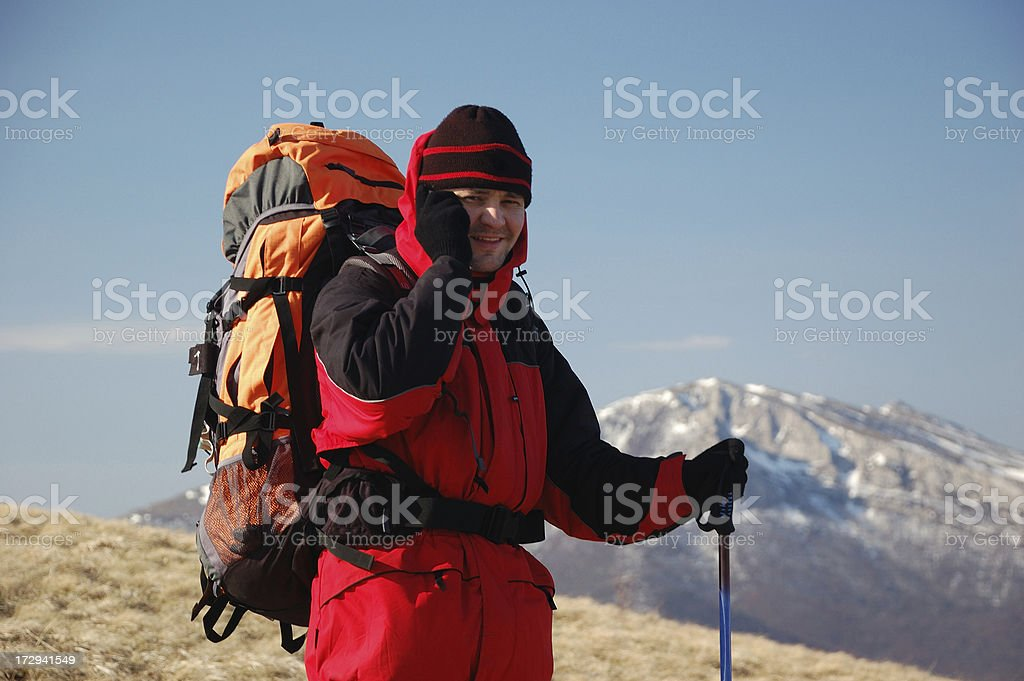 Hiker talk by radio in mountain royalty-free stock photo