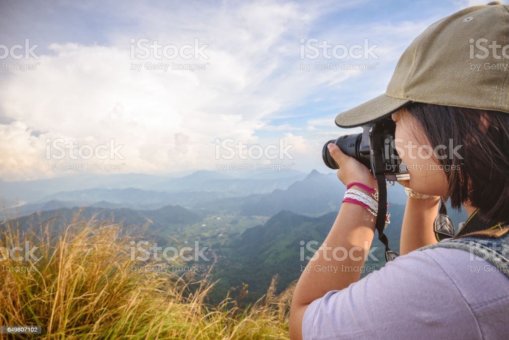 Hiker teens girl taking photo stock photo