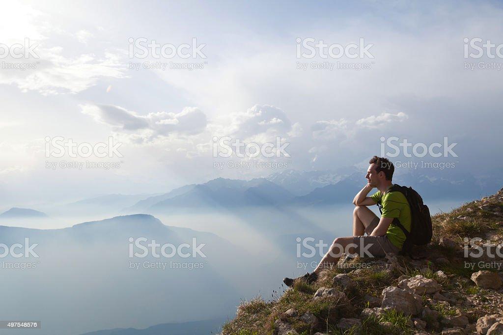 hiker traveler enjoying panoramic view of mountains stock photo