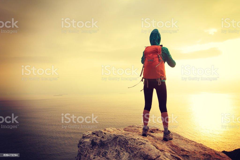 hiker use digital tablet taking photo on seaside mountain peak stock photo