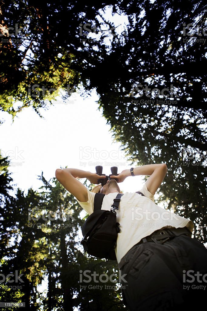 Hiker Using Binoculars stock photo