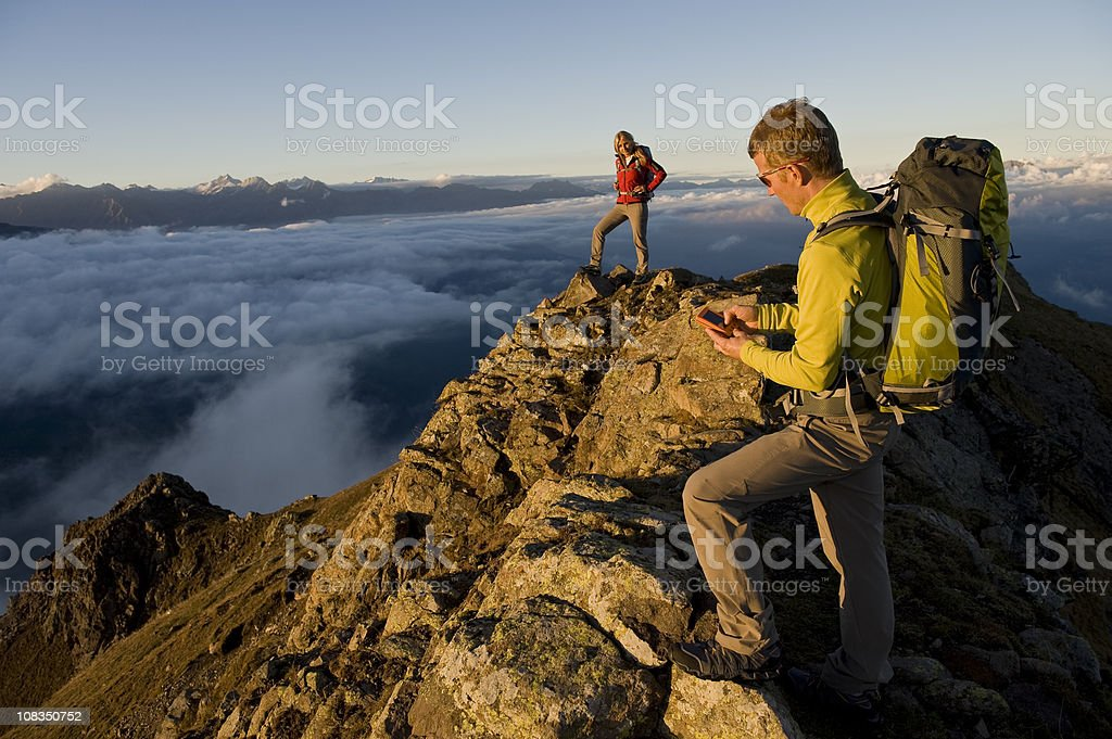 Hiker using GPS stock photo