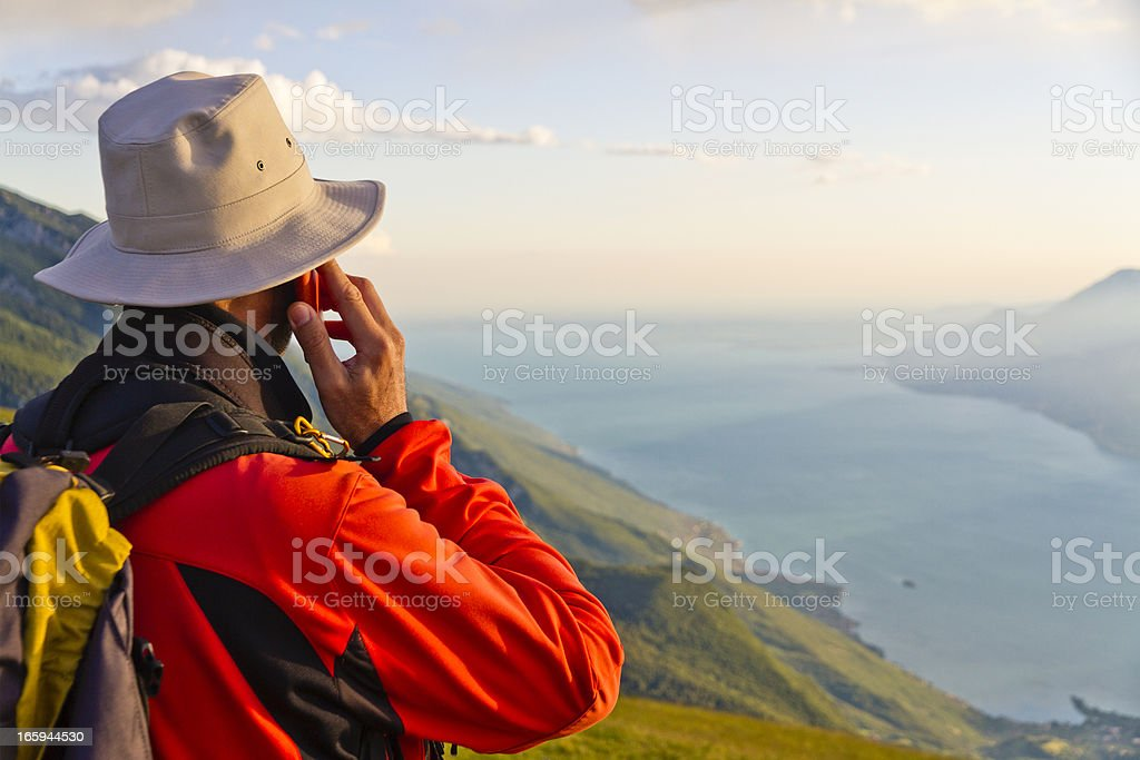 Hiker using mobile phone royalty-free stock photo