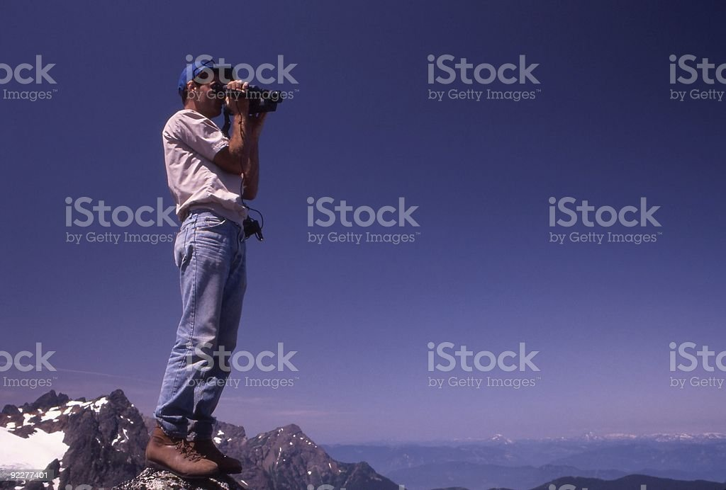 Hiker Video Taping Mountains stock photo