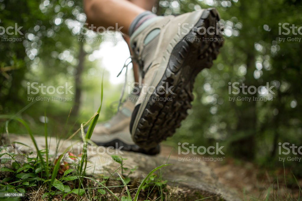 Hiker walk on a mountain trail-Low angle stock photo