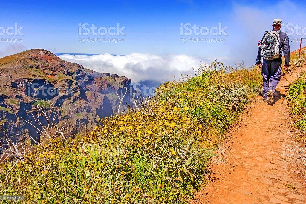 Hiker walking on path - Madeira mountainscape stock photo
