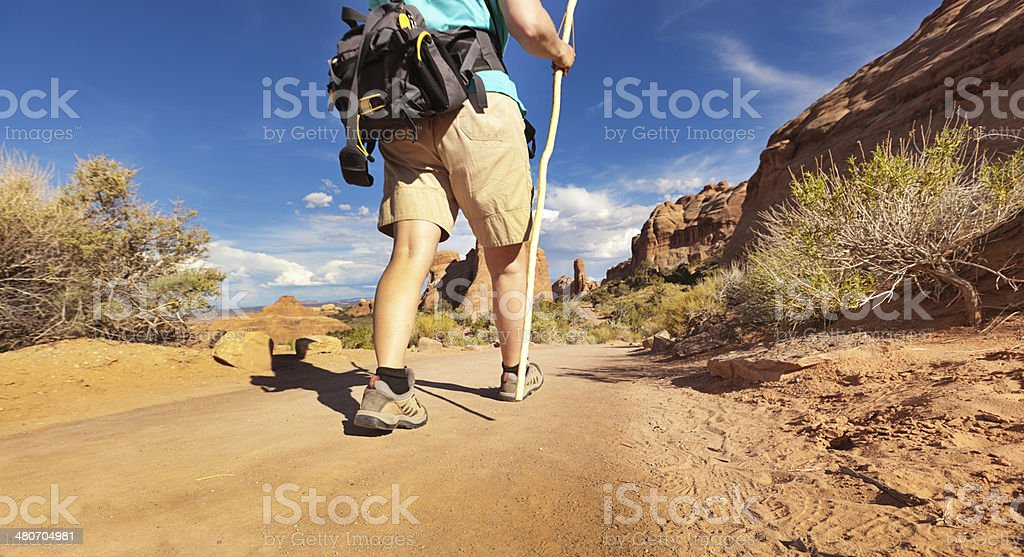 Hiker Walking the Hiking Trail in Arches National Park, Utah royalty-free stock photo