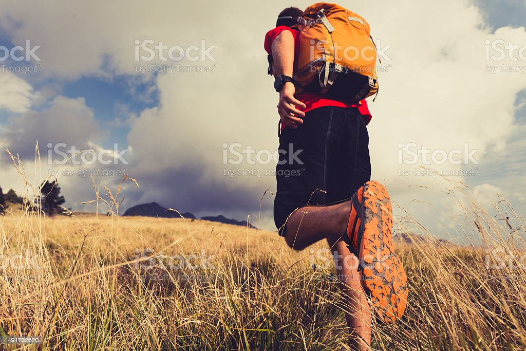Hiker walking with backpack stock photo