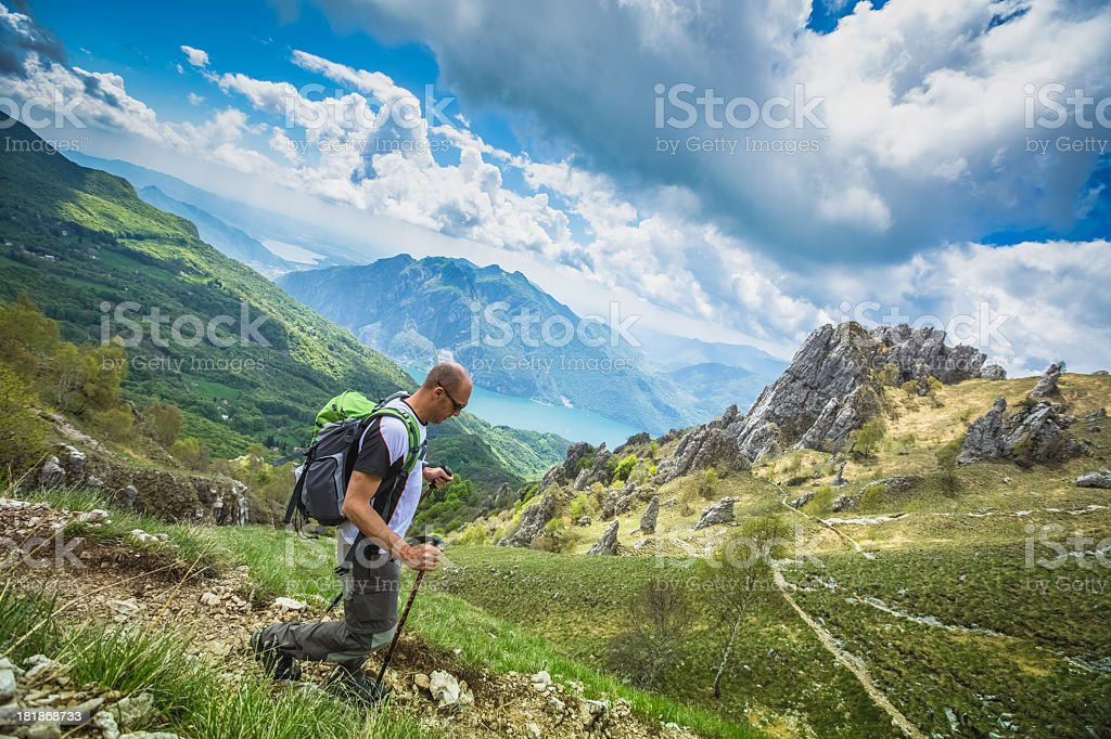 Hiker walks on Mountain Trail stock photo