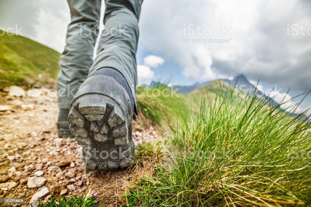 Hiker walks on Mountain Trail stock photo