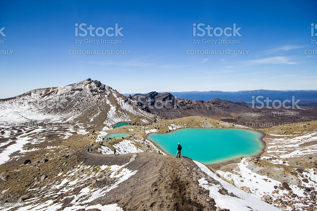 Hiker watching over emerald lakes stock photo