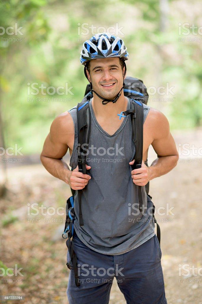 Hiker wearing a helmet stock photo