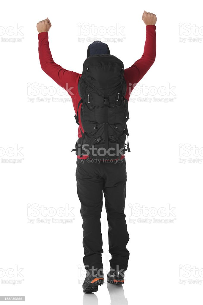 Hiker with arms raised royalty-free stock photo