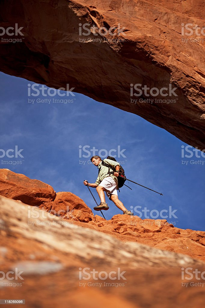 Hiker With Backpack And Poles Hiking In Moab, Utah royalty-free stock photo
