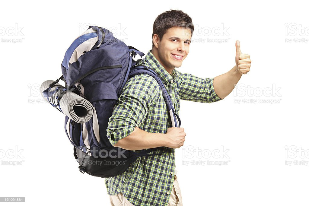 Hiker with backpack giving thumb up royalty-free stock photo