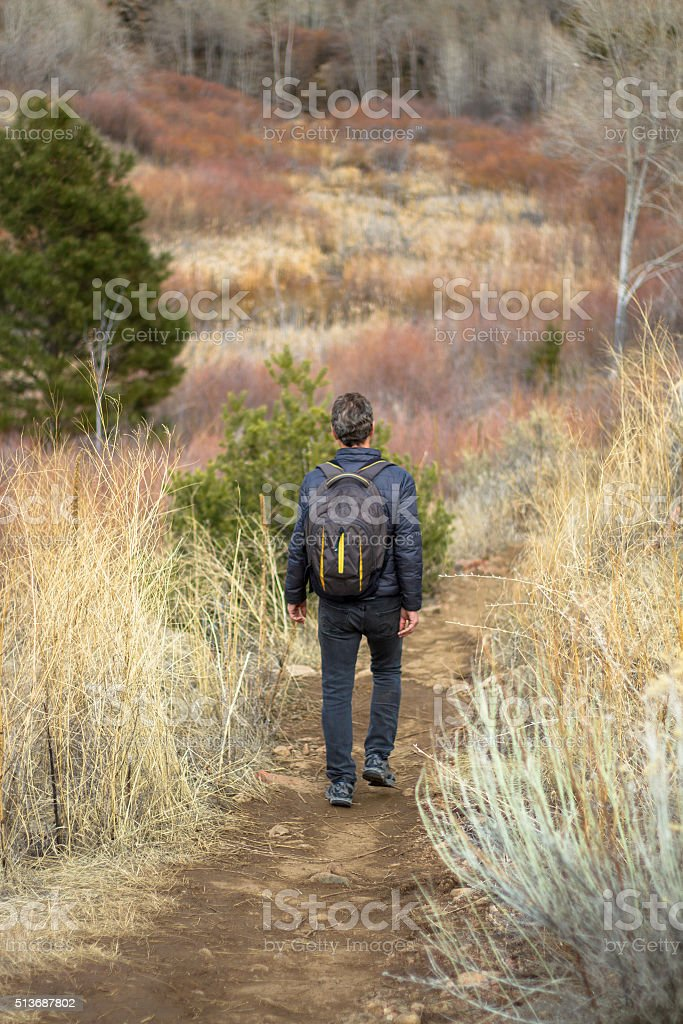Hiker with Backpack in US Southwest Wilderness stock photo