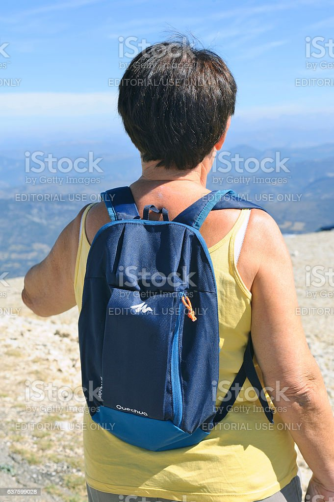 Hiker with backpack reaching the summit of Mont Ventoux stock photo