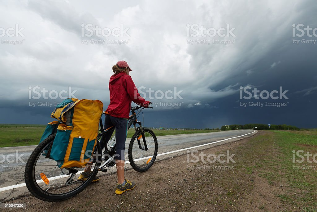 Hiker with bicycle stock photo
