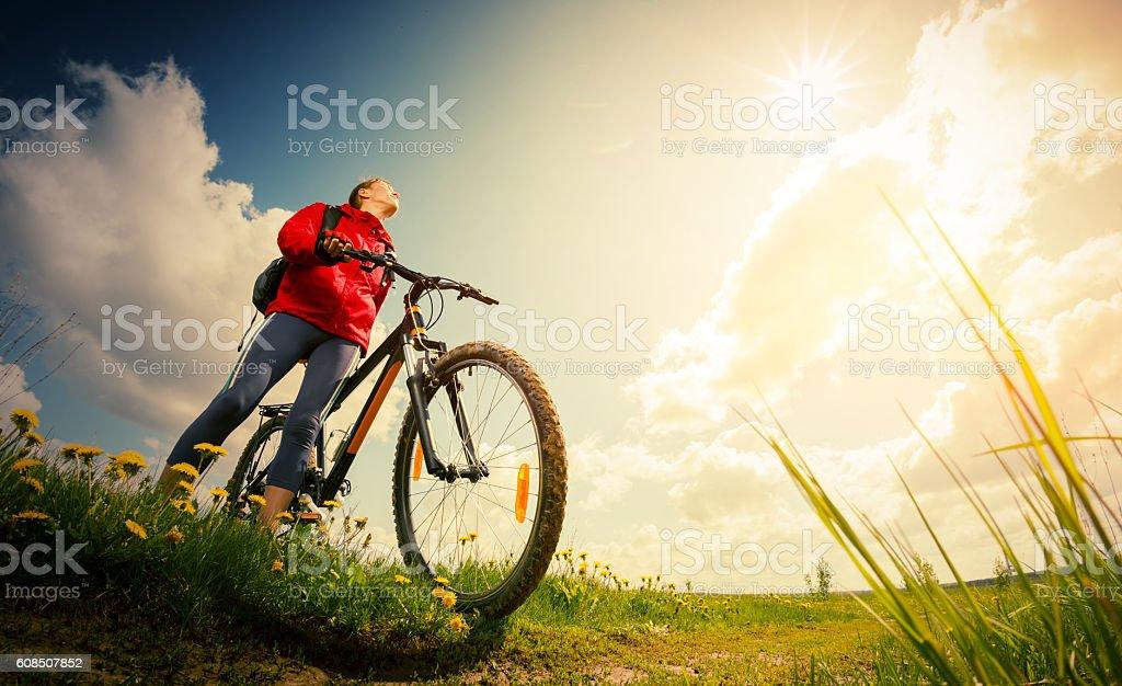 Hiker with bike stock photo