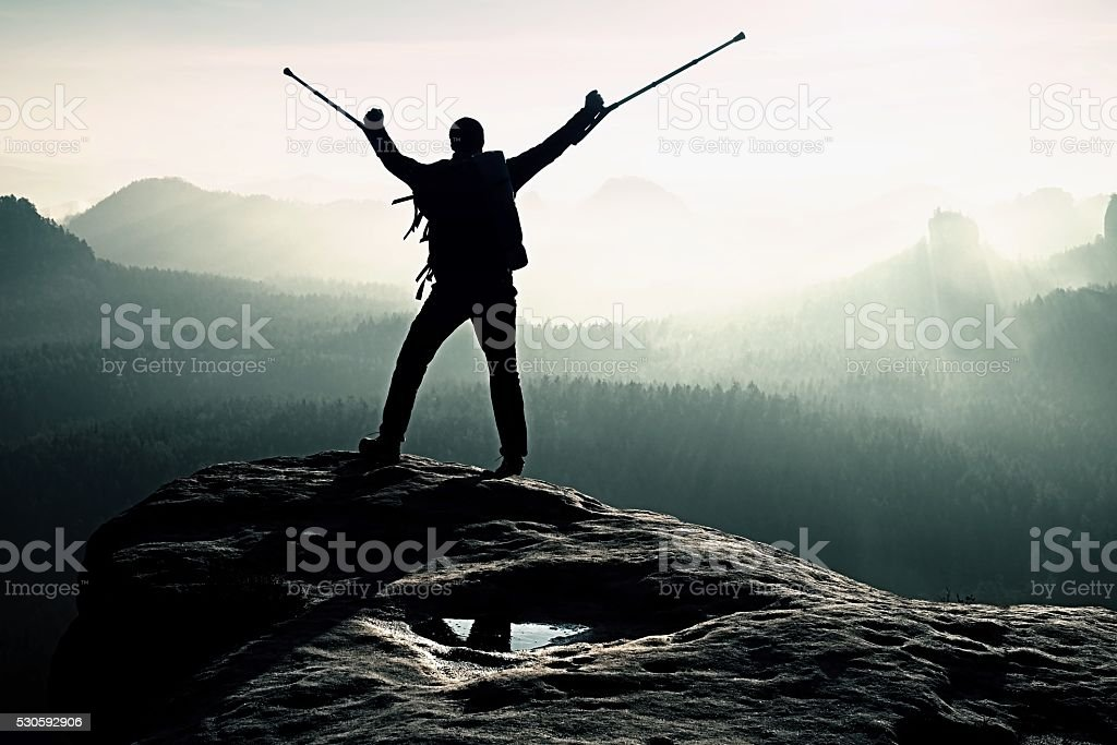 Hiker with broken leg in immobilizer and medicine pole stock photo