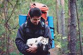 Hiker with cat in hands