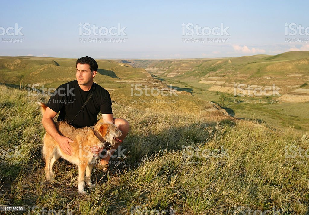 Hiker with dog enjoying view stock photo