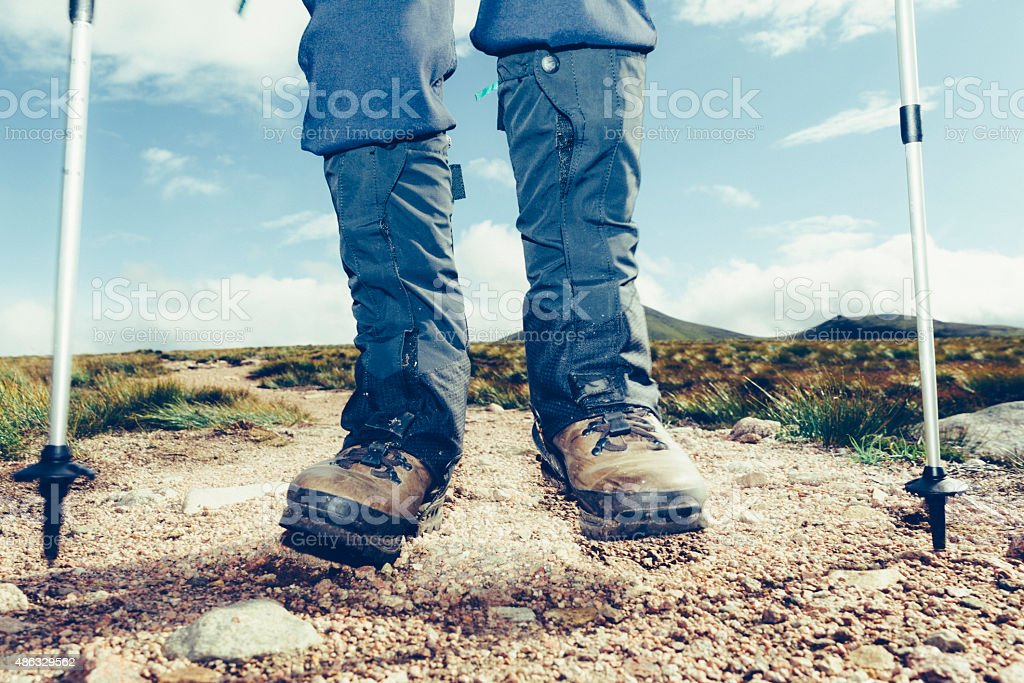 Hiker with gaiters on trail stock photo