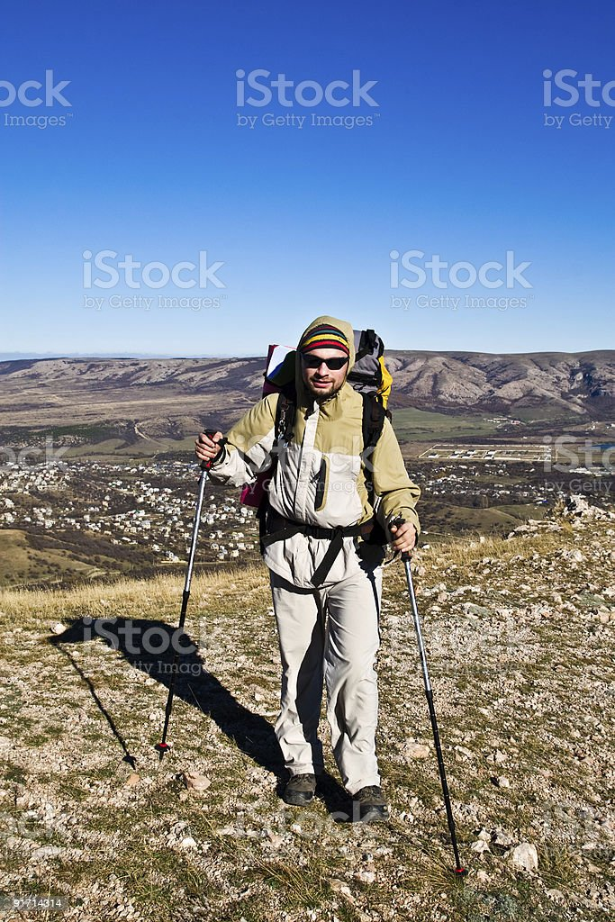 Hiker with hiking poles royalty-free stock photo