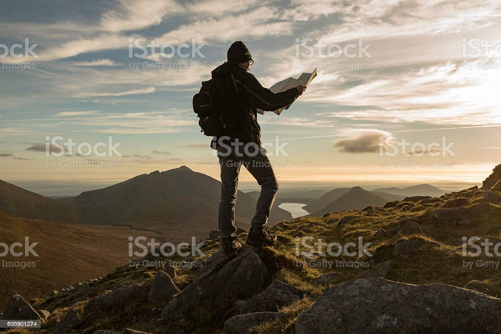 Hiker with map, Mourne Mountains, Northern Ireland stock photo