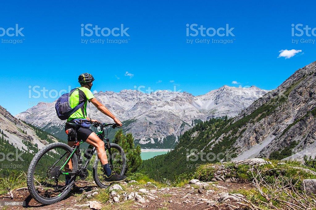 Hiker with mountain bike stock photo
