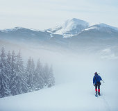 hiker with snowshoes in winter. Carpathian, Ukraine, Europe.