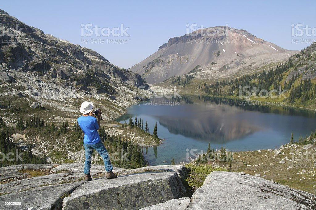 Hiker with Video Camera Above Ring Lake royalty-free stock photo