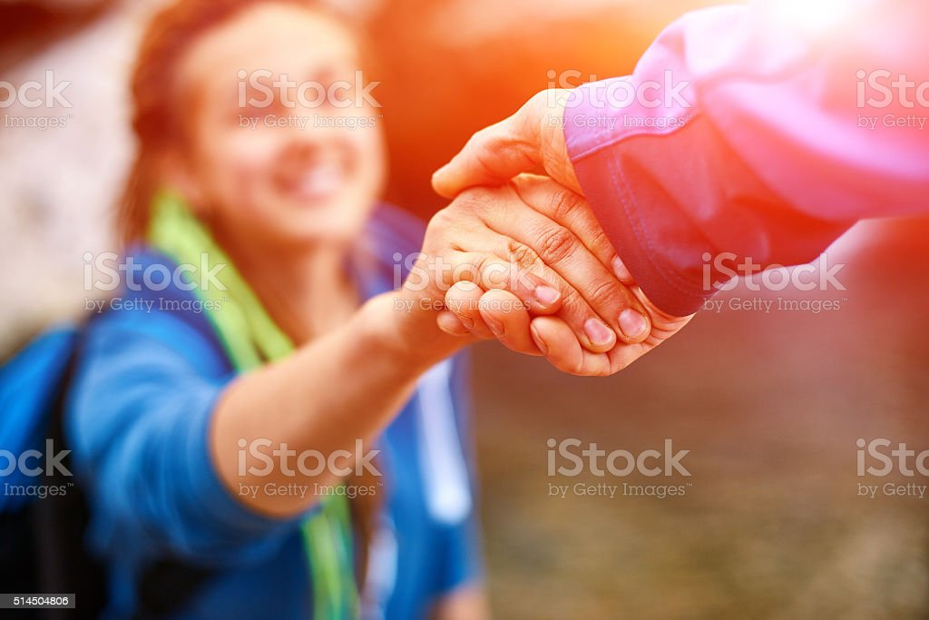 hiker woman getting help stock photo