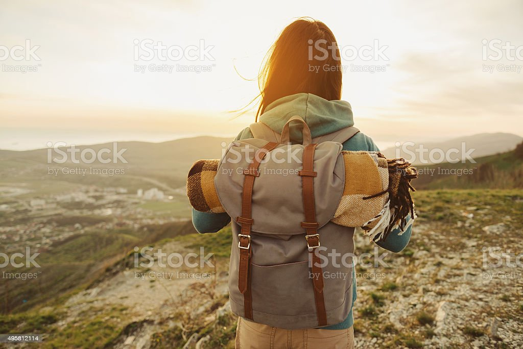 Hiker woman walking outdoor at sunset stock photo