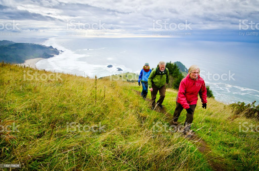 Hikers above the Coast stock photo