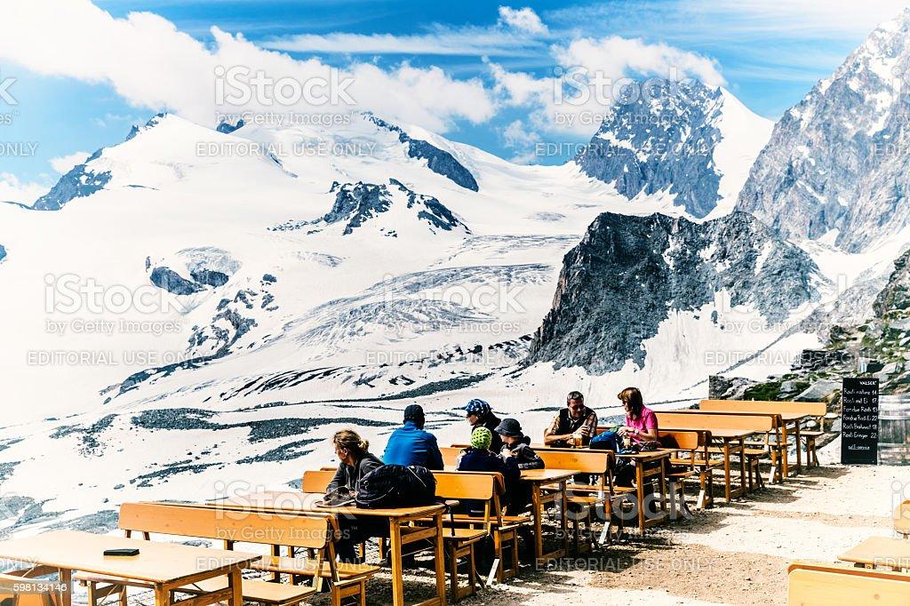 Hikers at the Britannia Hut, Switzerland stock photo