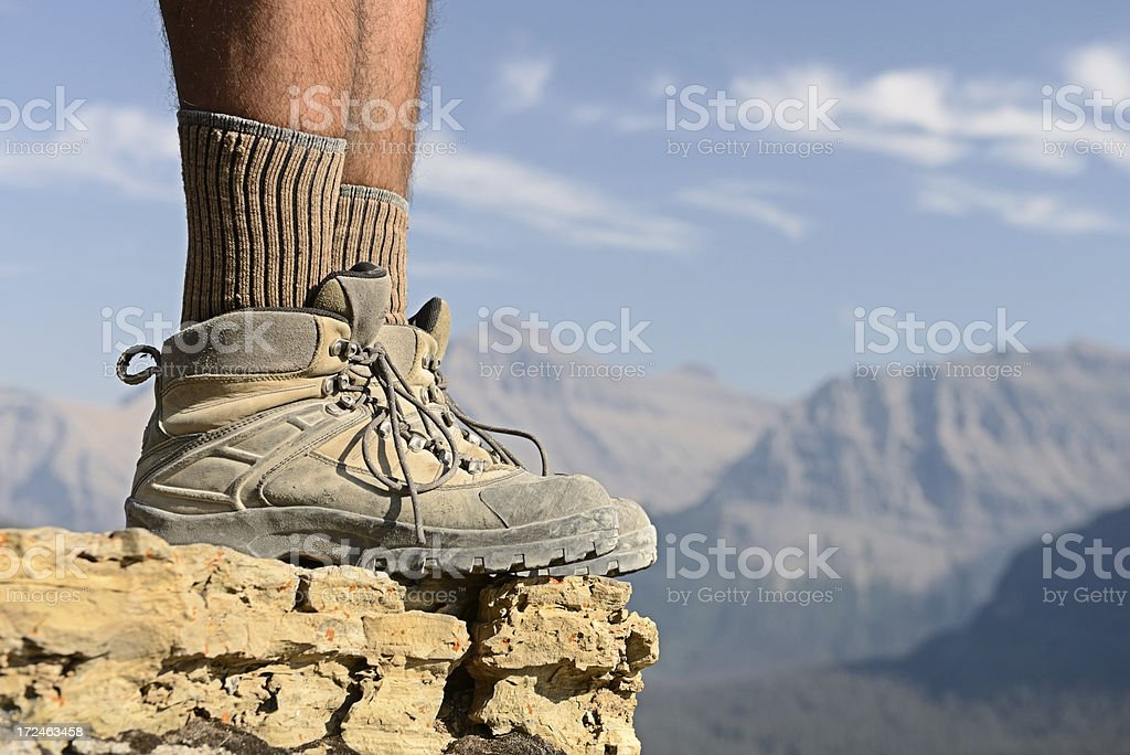 Hiker's Boots Facing Sideways At Mountain Overlook royalty-free stock photo