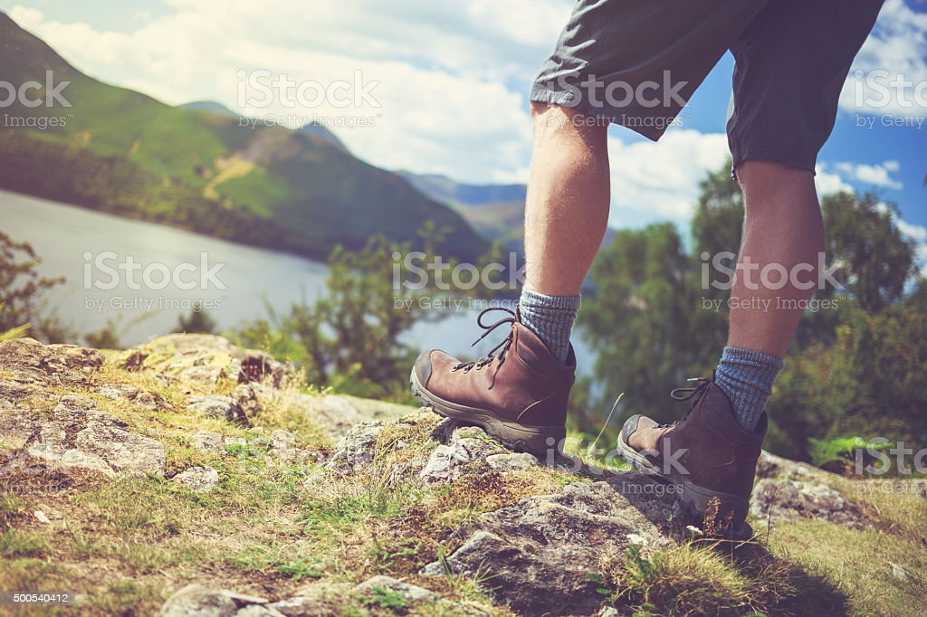Hikers boots with Lake District landscape - UK stock photo