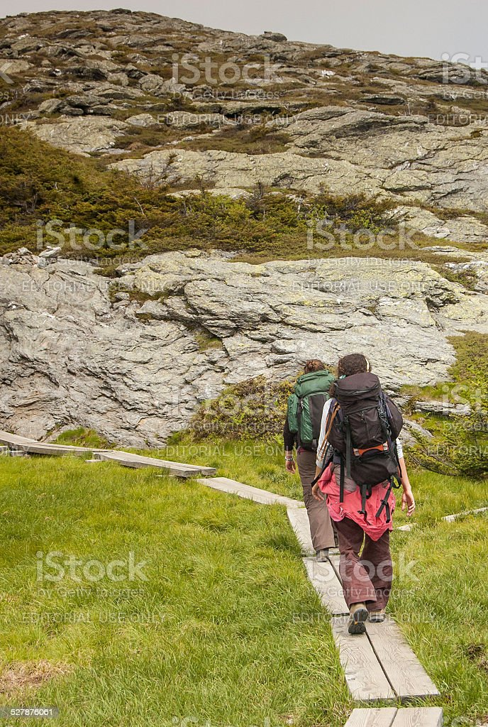 Hikers Climb Mt. Mansfield in Vermont stock photo