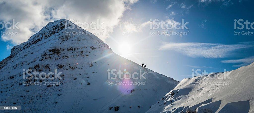 Hikers climbing Pen y Fan in winter Brecon Beacons Wales stock photo