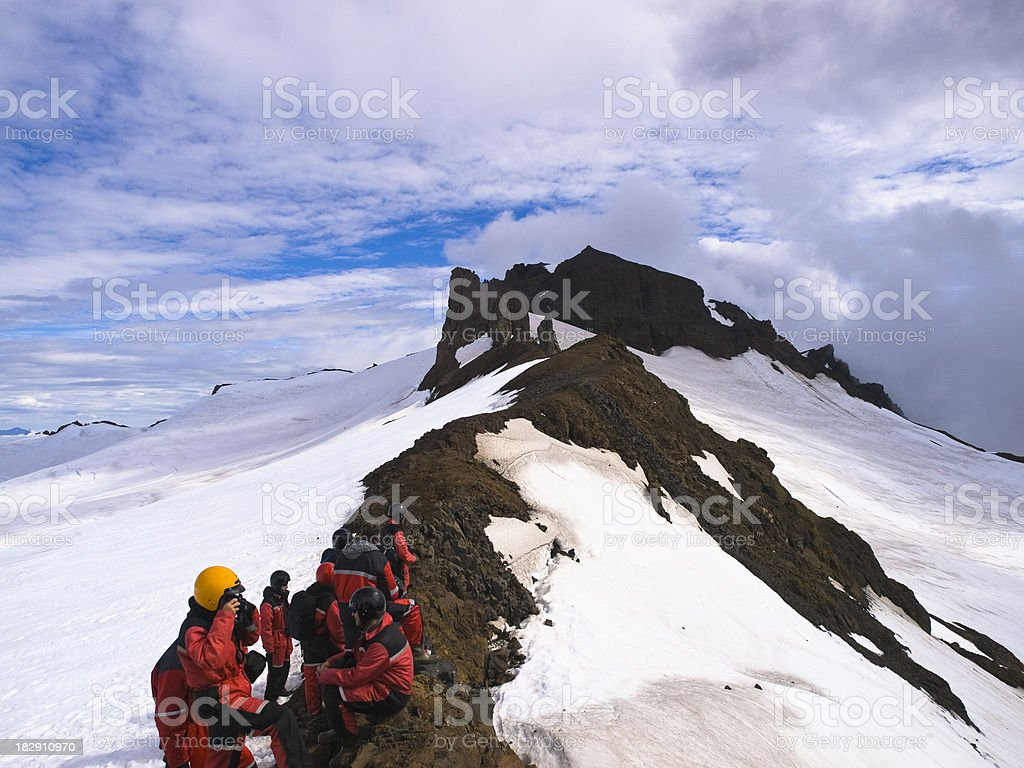 Hikers climbing Vat animal glacier in Iceland stock photo