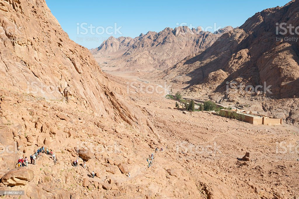 Hikers descending Mount Sinai to St. Catherine's Monastery stock photo