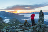 Hikers enjoy mountain sunrise